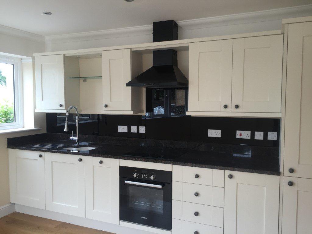 Black Kitchen Coloured backsplash