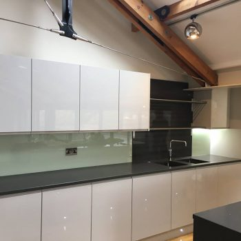 coloured glass splashback and wortops