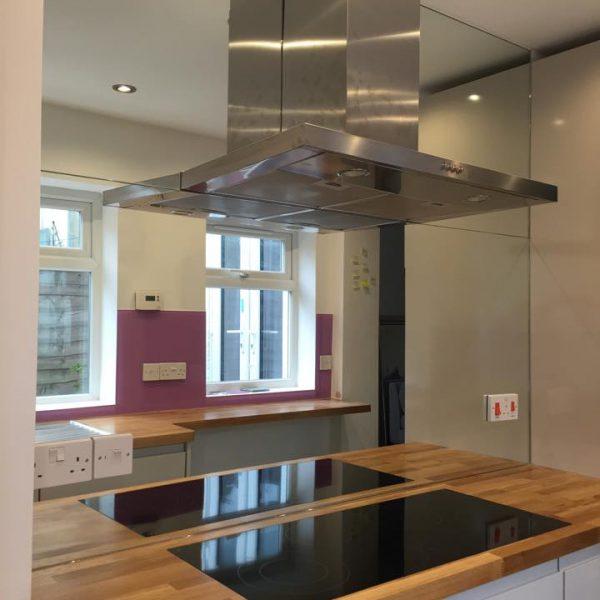 mirrored splashback kitchen